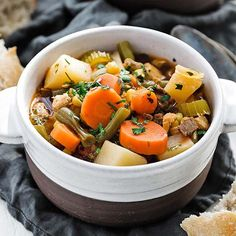 Mulligan stew, also known as hobo stew, is a free-for-all and easy to make delicious hearty soup crammed with beef, chicken and vegetables in a tasty beef broth. #mullinganstew #beefstew