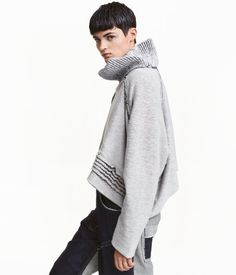 White/dark blue. DESIGN AWARD. Short, oversized cowl-neck sweater in three layers ‒ one reverse-stitched layer in sweatshirt fabric, one jersey layer, and
