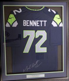 seattle seahawks michael bennett autographed framed blue nike jersey mcs holo