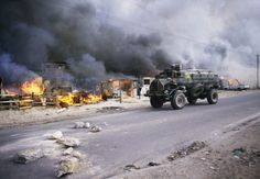 A South African security forces armored vehicle patrols by hundreds of burning houses in the KTC squatter community camp 09 June 1986 in Cape Town. Environmental Analysis, Apartheid, Armored Vehicles, African History, War Machine, Cape Town, Squats, Monster Trucks, Youth