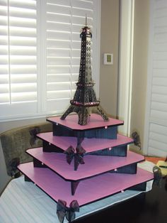 Did someone say Eiffel Tower themed cupcake stand? Ok this would be good for Wedding Cupcakes for the Guest!! @Josie Tanner  Pretty !!