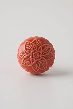 """saw these """"red"""" knobs in person today at Anthropologie...  not red at all... more like a terracotta/peach color.  Still pretty, though."""