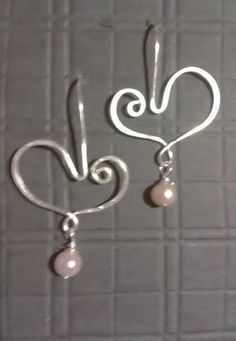 Wire Art Silver Heart Earrings adorned with Pink by PiacereMusic on Etsy  http://www.etsy.com/listing/91782710/wire-art-silver-heart-earrings-adorned?ref=tre-1993324152-10