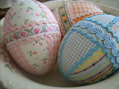 Handmade Fabric Easter Eggs.  People are so creative.  I never thought to use fabric on eggs.  I love the pink egg with tiny rose buds, with the darling pink floral ribbon.