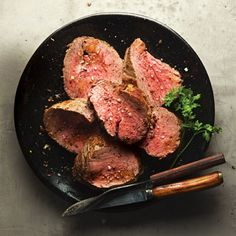 Rosemary-Rubbed Beef Tenderloin Recipe - always a favorite ....rosemary from our garden and a little fresh horseradish on this side...I make this on the grill 1 hour ahead so that it has time to rest. slice right before serving. #saveur #dinnerparty