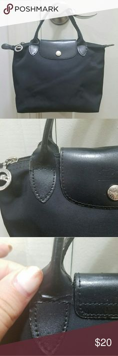 Longchamp Black Mini bag Black Longchamp bag small bag with zipper and snap closure. Handle is not in the best shape (see image). Great day bag; fits all your necessities! Longchamp Bags Mini Bags