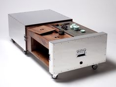 naihan li conceals furniture functions in metal crates