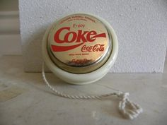 I had the plain old Sprite white/green yoyo, but I so desperately wanted this Gold Coca-Cola spinner! Do you have any idea how many cans I went through looking for the winning ring-pull?!