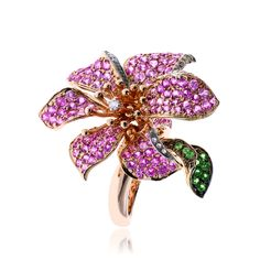 18kt yellow gold, pink tourmaline, tsavorite garnet and diamond flower ring.
