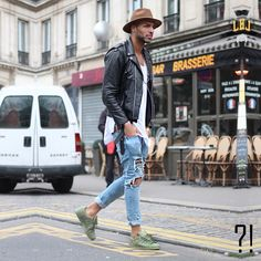 Create your own Vibes ... Stephane wearing military green adidas superstar. Ripped jeans. White shirt and a leather jacket