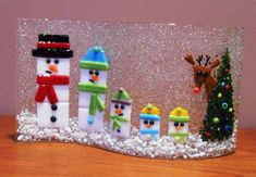 Snow Family With Rudolph - from Delphi Artist Gallery by KLacy