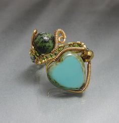 Copper Handmade Wire Wrapped Ring with Green Heart. $27.00, via Etsy.
