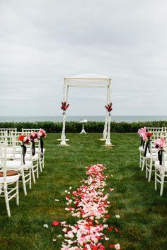 Rose petals line this Cape Cod wedding aisle: http://www.stylemepretty.com/massachusetts-weddings/cape-cod/2014/11/07/modern-chic-cape-cod-wedding/ | Photography: Joyelle West - http://www.jwestwedding.com/