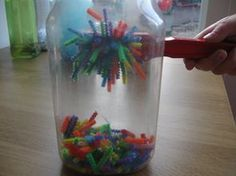 Discovery bottles for kids. This site has a list of ideas for various fillers for these science and sensory discovery bottles. This one is filled with cut up pipe cleaners. Use magnetic wands to draw the pipe cleaners up the side of the bottle. Preschool Science, Craft Activities For Kids, Science Activities, Science Experiments, Projects For Kids, Preschool Activities, Science Fun, Science Ideas, Science Bottle