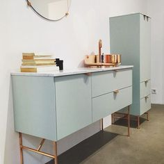 Cabinet handles etc. :: Inside our Stockholm showroom. An Aerugo Green vanity unit built on Ikeas Metod Wall cabinets. It's 120cm wide/40cm deep/40cm high. Legs are the 37cm high Angles legs in copper, washbasin is the SuperSink in solid and untreated copper, and the tap is the Tapwell Evo - also in untreated copper that will give the metal a beautiful patina. Handles are Holy Wafers in copper. The Carrara Marble stonetop...