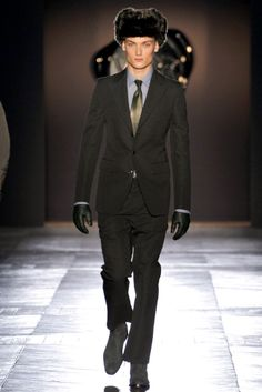 50's single breasted, thinner tie and lapel, shorter cut on pants. Fall 2012 menswear Viktor & Rolf