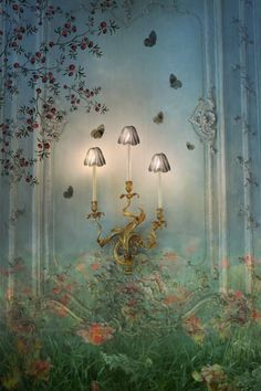 forest painting on French paneled wall with flower sconce.