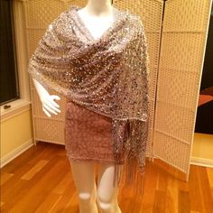 Sequined evening wrap Glittery silver sequined wrap  or shawl. Perfect for prom, black tie, wedding. Matching gray fringe on both ends. Polyester, hand washable. Tag on it, not price tag. Accessories Scarves & Wraps