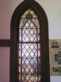 ..a stained glass window in the oldest church from the 1800's