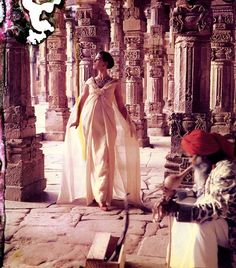 Wearing an evening gown by Dior, photo by Norman Parkinson taken at 'The pillars of Quwat-Ul-Islam Mosque', Dehli, India, 1950s