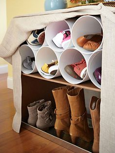 Reclaim a Bookcase  Eliminate entryway clutter by morphing an existing bookcase or end table into a fashionable hub for shoes. Hanging shelf dividers and a galvanized tray keep boots upright and off the floor while short sections of PVC pipe hold pairs on the shelf above.