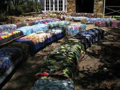 hay bale wedding seating with vintage/country quilts. How sweet!