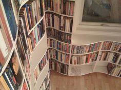 Curving book shelves... interesting #coolest #bookshelves