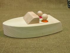 Floating wooden boat toy by uswoodtoys on Etsy, $15.00