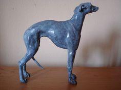 Bronze Dog sculpture by artist Emma Walker titled: 'whippet bronze'