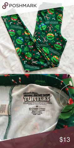 "Teenage Mutant Ninja Turtles Ugly Xmas Leggings Teenage Mutant Ninja Turtles Christmas Leggings NWOT.            Measurements Laying Flat Size 🔹 M Waist 🔹13"" Inseam 🔹 29"" Bundle to Save 🤓 Sorry NO outside transactions 🚫 NO trades 🚫 Reasonable Offers welcomed 👍 NO Low balling 👎 NO modeling 👎 NO Holds👎 All items from a pet 😼and Smoke Free Home  Happy Poshing 🤗 Nickelodeon Pants Leggings"