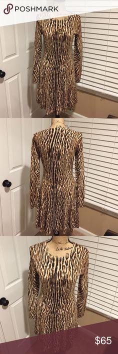 Michael Kors Dress Michael Kors Dress A-line cut  beautiful soft material so comfortable to wear.  This Dress was well Loved! Michael Kors Dresses