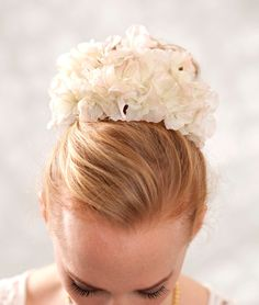 A ribbon based vintage flowers headpiece which you can also use as a sash.  The flowers are somewhere between white and ivory... they are original vintage silk flowers.  I added some peach colored lace on the edges and some small pearls.  This is an amazing piece which you'll enjoy for a very lo...    $100