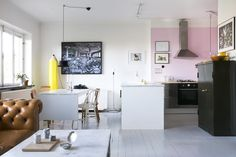 surrealist apartment with pink kitchen