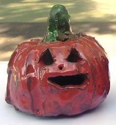 Art Projects for Kids: Ceramic Pumpkin.Two pinch pots fused together make a ball. Add a stem and cut out the face and you have a cute pumpkin!