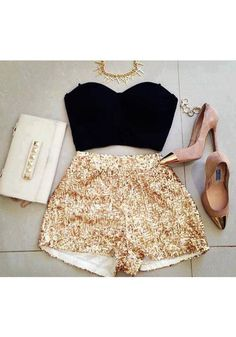 Gold statement necklace,  black crop top, gold sequence shorts and blush pumps