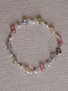 pastel colored bicone crystals and pearls. bracelet with individual links