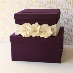 Purple Tiered Wedding Card Box: They say that purple is the color of royalty, and this deep purple tiered wedding box ($102) will surely make you feel like a princess on your big day.