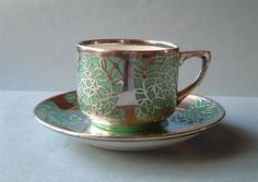 cup and saucer silver overlay
