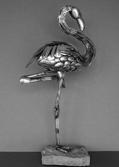 This art sculpture was made using recycled scrap metal and cutlery. Welding Art Projects, Metal Art Projects, Metal Crafts, Aluminum Crafts, Metal Sculpture Artists, Steel Sculpture, Art Sculptures, Sculpture Ideas, Abstract Sculpture