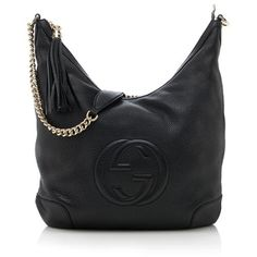 A classic Gucci shoulder bag in luxe black leather with a central interlocking-G logo and gold-tone hardware. Details include a chain strap, oversized tassel, zip closure, and fully lined interior with two open pockets and one zippered pocket.