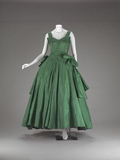 1954, Dior: Christian Dior-New York, which opened in 1948, produced Dior designs at more affordable prices for American women. This dress is an example of that line of luxury ready-to-wear.