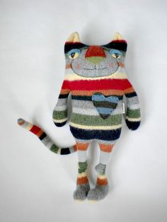 Striped Tiger Cat Stuffed Animal from Wool Sweater Felted Repurposed    I made this sweet kitty from a wonderful striped 100% wool sweater. I love