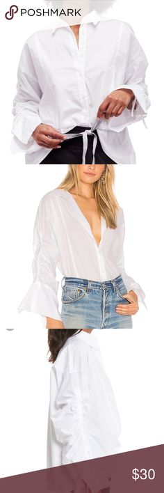 """🆕 Free People Brown Eyed Girl Poplin Top • Sz S Brand New with Tags!   Free People Brown Eyed Girl Poplin Blouse  • Size Small • White  • Length = 27""""  • 100% Cotton  • Oversized  • Ruched Sleeves   Have questions 🤔❓Comment below 🤗❗️  🔥 Five Star Seller  🔥 Fast Shipper  🔥 PoshMark Ambassador Free People Tops Button Down Shirts"""