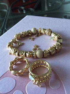 Gold pandora bracelet and rings