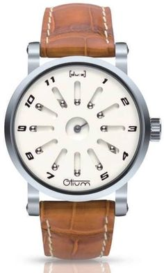 Otium Watch uses silver balls to indicate time.