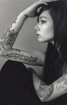 I really like the placement of her tattoos, how there are spaces without anything rather than them being very crowded together.
