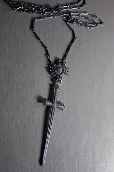 Items similar to Suite of swords. Tarot necklace. on Etsy fa471eae5fd81