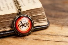 Tiny bicycle pendant bicycle necklace orange necklace by SomeMagic