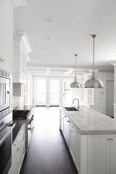 white galley kitchen with island