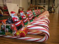 My mom and I make these every Christmas. Really cheap and easy gifts to give to family, neighbors, and friends. We hot glue the candy together.